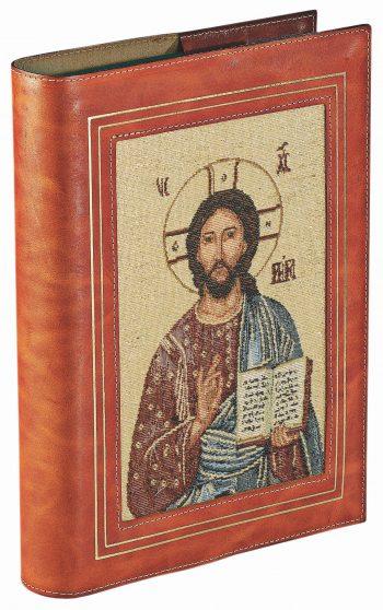 """Coprilezionario """"Cristo Pantocratore"""" in pelle con inserto in tessuto lavorato a telaio raffigurante il Cristo Pantocratore"""