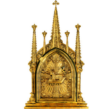 Golden altar tabernacle hand made in gothic style richly decorated with symbols of the Lamb of God and the seven Seals