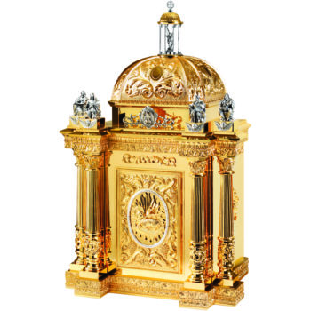 Baroque style brass table tabernacle decorated with Agnus Dei on the door, columns and dome surmounted by the four evangelists and St. Michael the Archangel